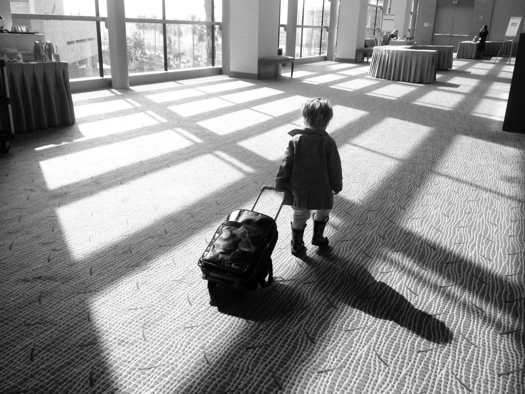 child pulling a suitcase