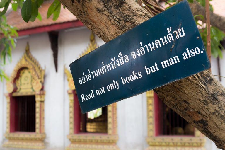 thai language sign at temple in thailand