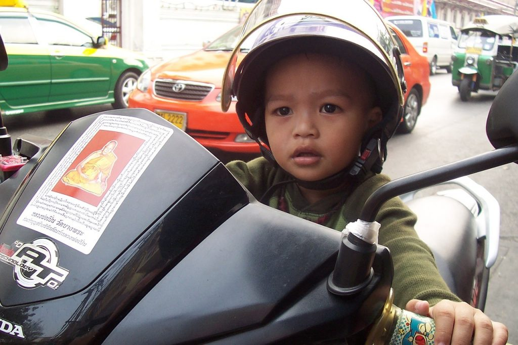 child driving motorcycle