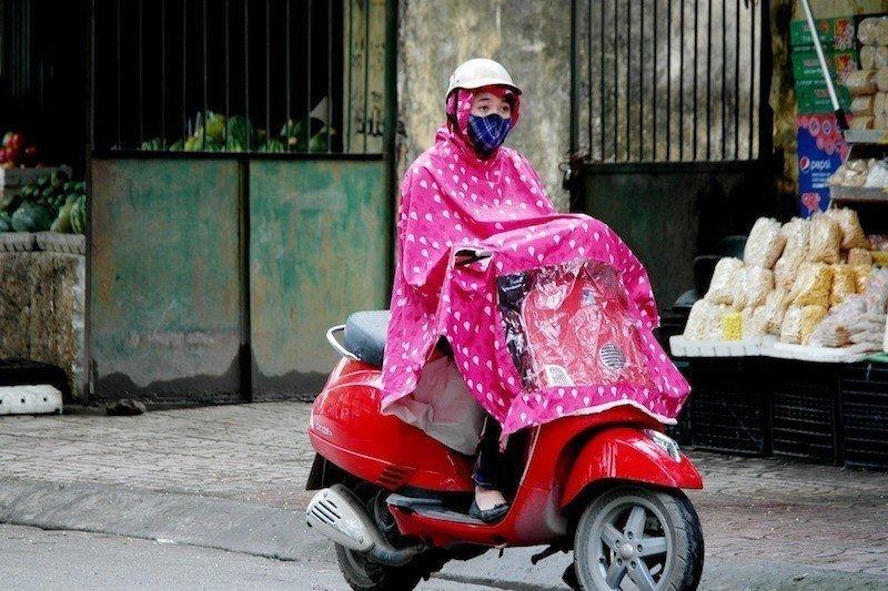 asian-woman-rainy-season-motorbike-rain-poncho