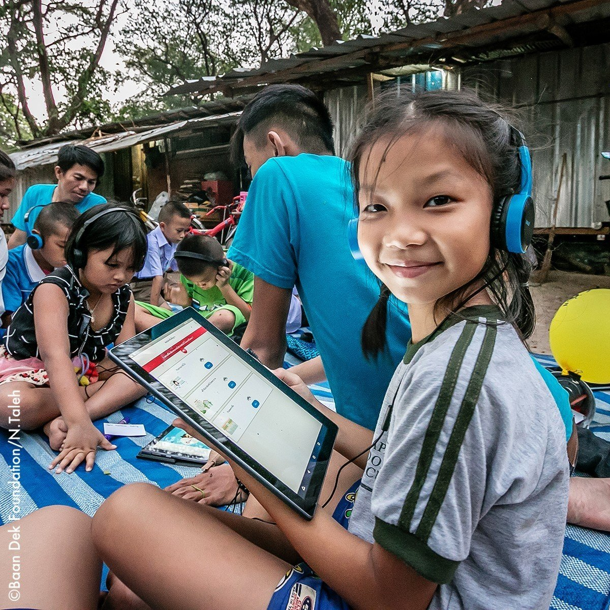 Child studying using a tablet computer