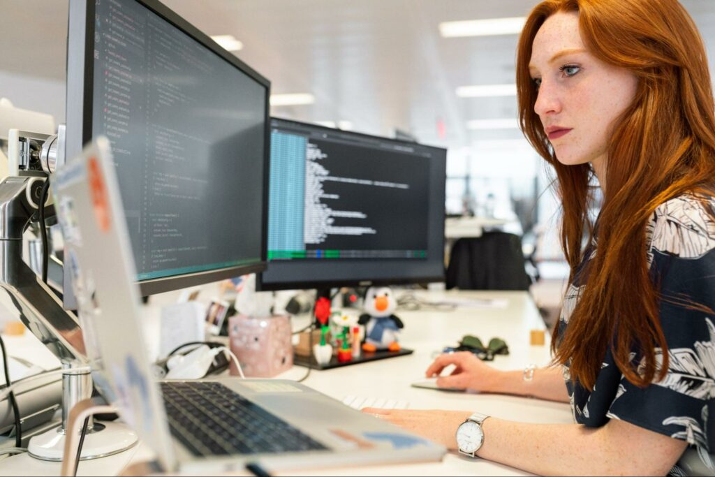 Red hair Woman coding IT